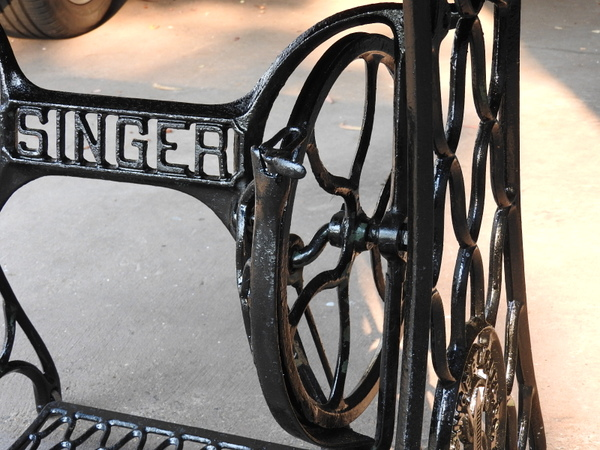 Marble top outdoor table on old cast iron Singer sewing machine base