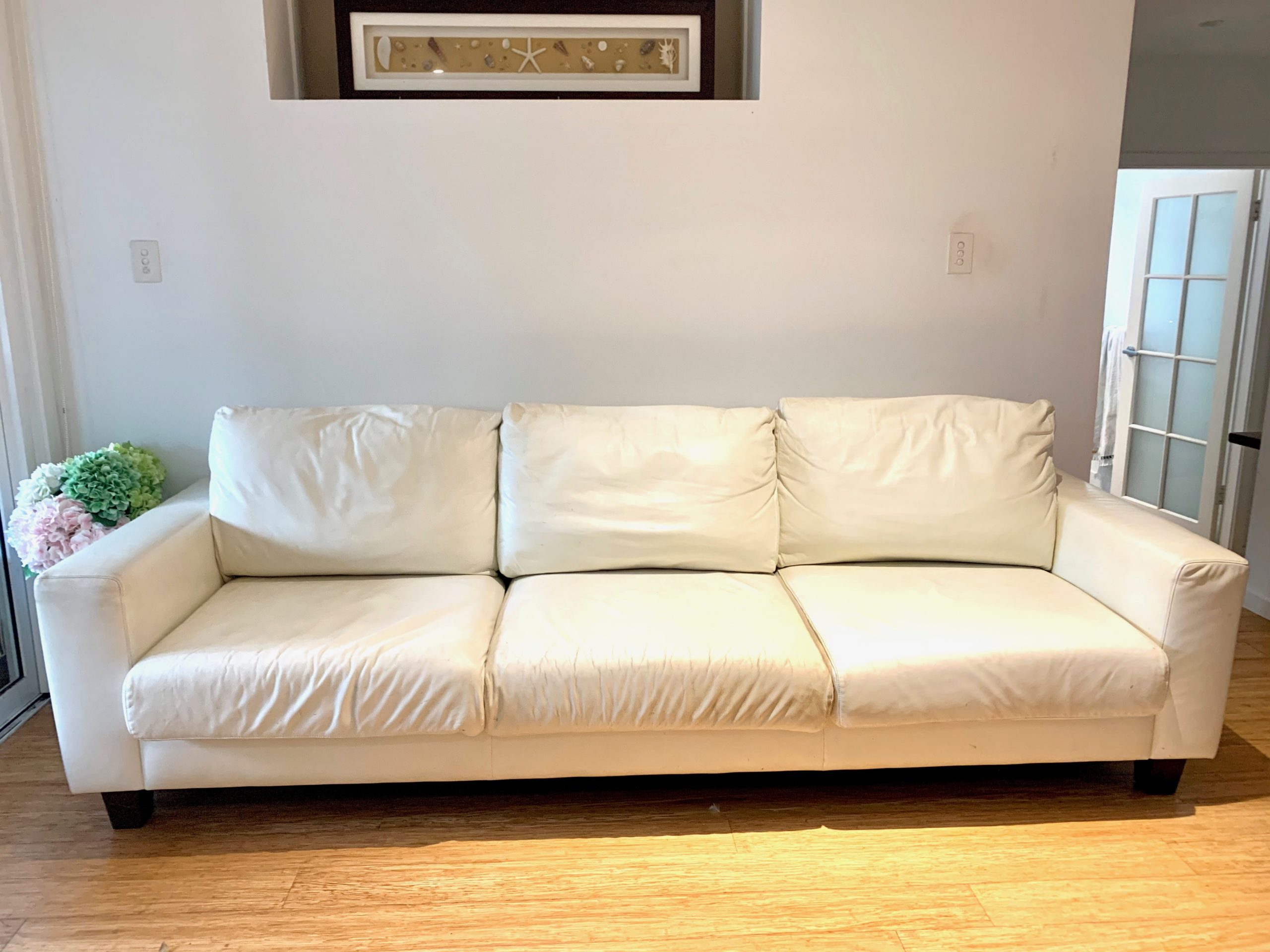 4 seater white leather lounge