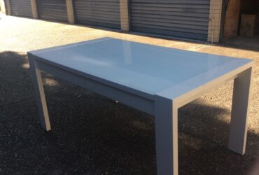 Glass topped white table